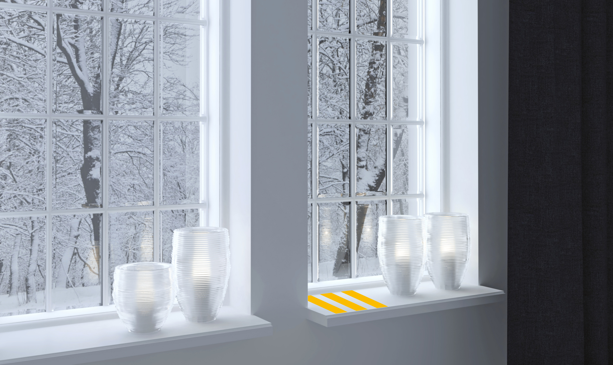 Inter shot of candles on a windowsill with snow falling