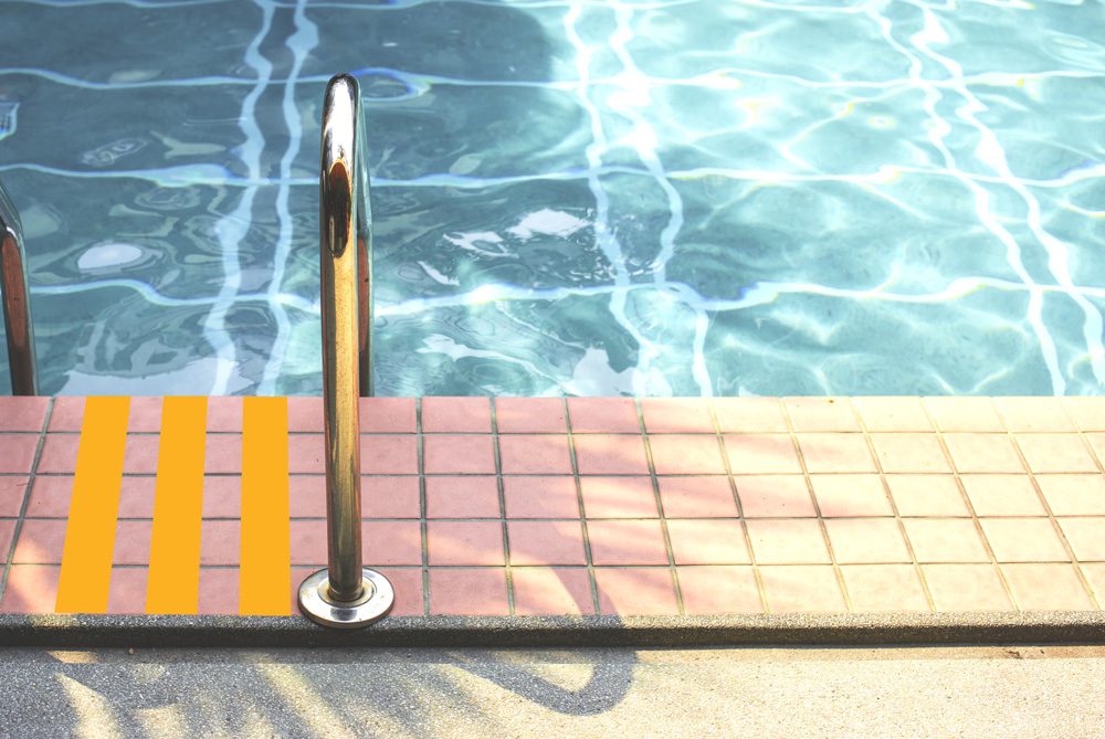 Edge of a pool with a metal railing